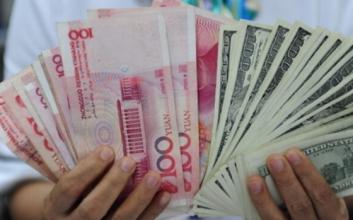 人民币中间价创八年半新低 离岸人民币失守6.94