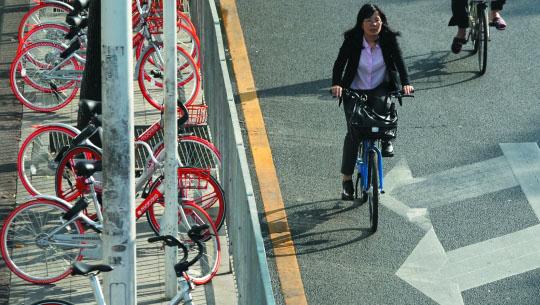 深圳试点共享单车智能锁车桩