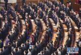 3月3日,中国人民政治协商会议第十二届全国委员会第四次会议在北京人民大会堂开幕。这是委员们高唱国歌。     新华社记者 杨宗友 摄